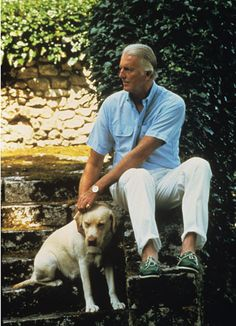 Hubert de Givenchy with his dog in 1990. wmagazine.com