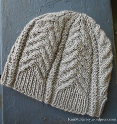 Construction: Otterbein is a cabled beanie-style hat with a ribbed brim that segues neatly into the cable pattern.