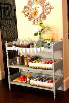 A diaper changing table turned buffet station  http://s702.photobucket.com/albums/ww27/pisforparty/Lilis%20Vintage%20Baby%20Shower/?action=view=851.jpg  #diaper #changing #table #repurpose #diy #food #buffet #server #serving