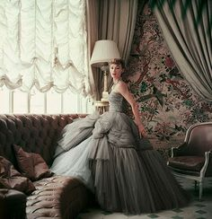 Model in home of Christian Dior, 1953. Photograph by Mark Shaw.