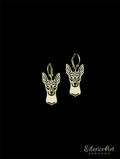 An unique Toy Fox Terrier earrings, designed by Amit Eshel.  This delicate fine jewelry will keep your small buddy close to your heart where