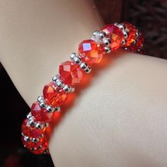 Beautiful beaded bracelet Classic glam! Iridescent red beaded bracelet with delicate beaded detail, elastic, one size fits all Jewelry Bracelets