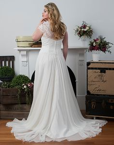 Soft lace and chiffon bridal gown from the Diva Curves collection by Peter Trends Bridal.