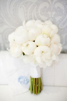 I like the idea of white peonies and dahlias, or in a radiant orchid colour, with just one lily <321