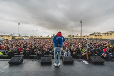 Kendrick Lamar performs at Nickerson Gardens in Watts, California for the 2nd Annual TDE Toy Drive. (Photo by Jeff Lombardo)