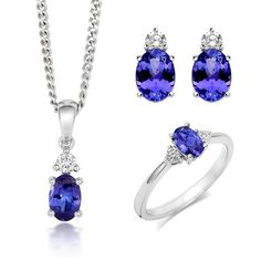 18ct White Gold Tanzanite Diamond Three Piece Gift Set, TVN-352 The pieces that comprise this exquisite gift set feature beautiful Tanzanite gemstones, discovered in the Mererani Hills of Northern Tanzania. They are an embodiment of elegance and luxury with Tanzanite being one of the world's most desired stones. This seductive gemstone can exhibit a variety of surreal colours including blues, violets and burgundies so each piece is truly unique and beautiful.  Ring: Tanzanite 0.57cts… Tanzanite Gemstone, Christmas Gift Sets, Latest Jewellery, Rose Gold Jewelry, Jewelry Packaging, Matcha, Natural Gemstones, Jewelry Gifts, White Gold