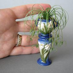 Miniature Spider Plant in Repro Roseville Jardiniere. $110.00, via Etsy..