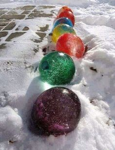 Fill balloons with water, add food coloring. Freeze and remove ballon. Frozen decorations for outside.