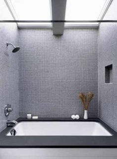 Tiny grey square tiles with white grout? And two off the shelf skylights (much less expensive than one frameless piece of glass) are cleverly combined into one in this bath by Ogawa Fisher Architects. Skylight Bathroom, Mosaic Bathroom, Bathroom Toilets, Bathroom Renos, Bathroom Interior, Modern Bathroom, Master Bathroom, Bathroom Grey, Mosaic Tiles