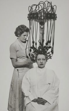 "Getting a ""permanent wave"" with the new Gallia machine, 1935"