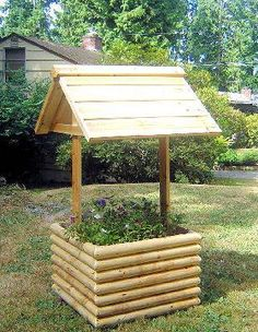 I want to build a wishing well planter to put on our rock bed in front of our house. with wood pier base and plants plus flowers. Wishing Well Garden, Wishing Well Plans, Outdoor Crafts, Outdoor Projects, Garden Projects, Outdoor Decor, Landscape Timber Crafts, Landscape Timbers, Outdoor Landscaping