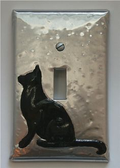 """Black Cat Silhouette Silver Toggle Switch Cover Plate Toggle. $15.95, via Etsy.  ...will go perfectly in my """"modern/retro"""" kitchen"""