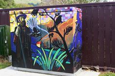 """Street Art, Christchurch, NZ - """"This is part of the cabinet art from Chorus. Am guessing it depicts the pioneers who can over the Bridle Path road""""."""