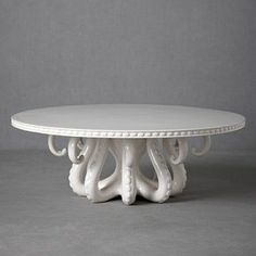 This is the most awesome cake stand that I have ever seen.  I can totally image serving a red velvet cake on this at Halloween