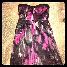 Mini Dress It is a pink, grey, white and black strap less mini dress. Shapes the body very nicely and is comfortable. It is in great condition, I only wore it twice. It zippers in the back. Dresses Mini