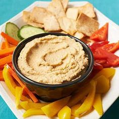 How to Make Traditional Hummus | Serve a traditional Middle Eastern dip made with chickpeas, tahini, lemon juice, and olive oil as a dip for fresh veggies at your next party.