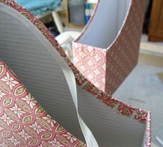 Covering magazine boxes in fabric.