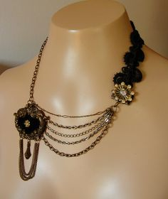 Vintage brooch repurposed - I have a sweater chain of my grandmothers that this would be cool to do with.