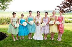 a spectrum of bridesmaid dresses