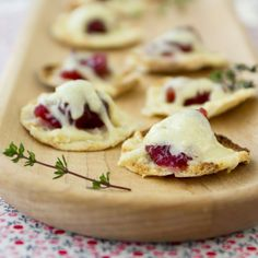 Recipe, grocery list, and nutrition info for Cranberry Cheddar Pita Bites. Elevate simple cranberry sauce from holiday table condiment to life of the party by pairing it with Cabot cheddar cheese in this recipe for cranberry cheddar pita bites. Appetizers For Party, Appetizer Recipes, Simple Appetizers, Snack Recipes, Appetizer Ideas, Thanksgiving Appetizers, Thanksgiving Table, Yummy Recipes, Free Recipes
