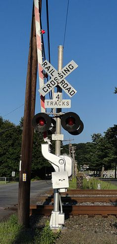 "View of grade crossing railroad signal on CSX River Subdivision in Kingston, New York. Signal manufactured by Safetran. The ""mech"", however, is manufactured by WCH.  (Western-Cullen-Hayes, Inc.)"