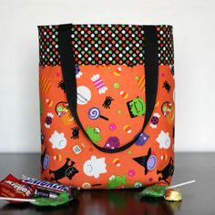 Design Your Own Halloween Trick or Treat Bag. It comes as a DIY kit or completed bag by Auntie Em's Crafts. 15 great Riley Blake fabrics to choose from!