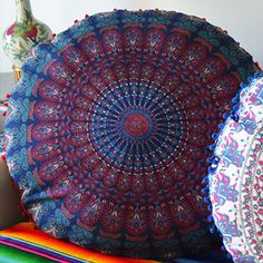 These extra large cushion covers are handmade from mandala tapestries. Available with a fringe or pom-poms. Double-sided. Approximately 34.5 inches in diameter. Because they are handmade, size may var