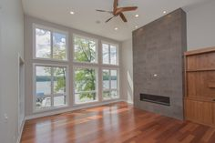 Living Area: Hardwood floors, ceramic tile floor to ceiling feature fireplace surround, floating gas fireplace, stained built-ins, large windows, natural light