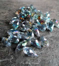 You will receive 10 of these sparkling faceted crystal briolettes in smoky clear / rainbow aurora borealis. Approximately 12 mm tall by 6 mm wide.  Please also visit me at:  The French Circus on Etsy, for my handmade vintage assemblage jewelry www.thefrenchcircusvintagejewelry.com, for product and blog updates http://eepurl.com/UD0if, to receive my monthly newsletter my Facebook page, https://www.facebook.com/thefrenchcircus follow The French Circus on Pinte...