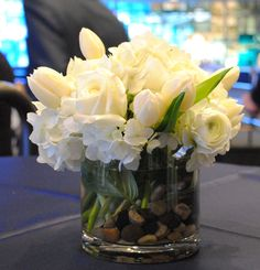 All white Spring wedding centerpiece
