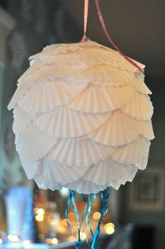 DIY pull string pinata covered with coffee filters. Wonder if I could color the filters somehow...