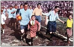 José Nasazzi (Uruguay, 1923–1937, 41 caps, 0 goal) leading his team, at the football final during the 1928 Summer Olympics Games. The tournement was won by Uruguay and would be the precursor to the 1st FIFA World Cup held in 1930 in Uruguay. Final : Uruguay vs Argentina 1-1 (1-0 Petrone 23', 1-1 Ferreira 50') at the Olympic Stadium (Amsterdam, Netherlands) on 10 June 1928. Replay Final : Uruguay vs Argentina 2-1 (1-0 Figueroa 17', 1-1 Monti 28', 2-1 Scarone 73') at the Olympic Stadium…