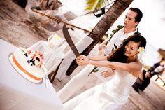 Ninja Bride slices cake // Hawaii destination wedding // Christine Chang Photography