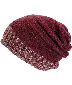This chunky knit slouchy beanie features a multi color ribbed cuff and a contrast solid overlay for a layered look.
