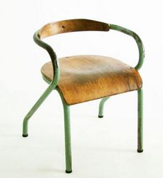 great way to energize a traditional interior. vintage olive/wood chair