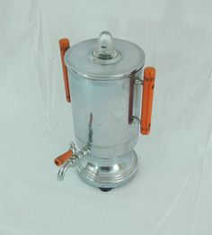 We are offering this Vintage Art Deco Farberware Percolator with Bakelite Handles. This is a unique and sleek looking piece. This coffee pot