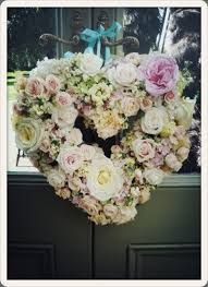 A heart wreath could be hung on the lych gate to welcome guests.  fairynuff flowers