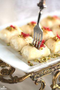 Halawet El Jibn (Sweet Cheese Rolls) 2 c Ater For the sweet cheese rolls: 1 c water ½ c sugar 1 c semolina 2 c mozzarella cheese, shredded 2 T rose water For filling the rolls: 1lb fresh eshta (clotted cream) Pistachios, ground Rose petal jam, for garnishing (optional)