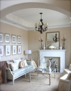 Fake Fireplace - chandelier - Coffee table - Sofa  Great neutral look :)