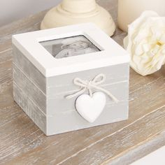 This shabby chic trinket box with photo frame makes a perfect gift idea for any occasion! Finished in French grey with a complementing white lid and hanging white heart; this trinket box will match any existing décor! Suitable for holding jewellery, trinkets or even keys, this little box is a great accessory for any dressing table!