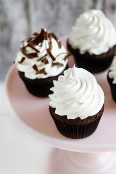 Chocolate cupcakes stuffed with a miniature Mallow Cup and topped with 7-Minute Frosting.