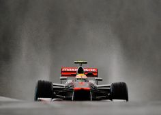 Lewis Hamilton ventures out through on to a very wet circuit on Friday morning | Formula 1 photos | ESPN F1