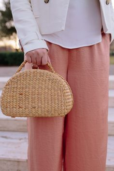 Fashion blogger Samantha Bigley of The Heart of the House wearing pink satin wide leg pants, jcrew blouse and seagrasstote basket bag