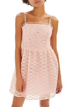 Pretty in pink in this romantic minidress with tulle ruffle trim