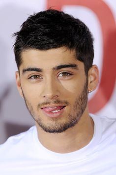 Pin for Later: Zayn Malik's Bad-Boy Transformation Will Make Your Heart Race 2013 The tousled hair, the wild arches, the stubble . . . Zayn is like the British cousin of Kevin Richardson from the Backstreet Boys.