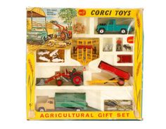 "Corgi Toys/Mettoy Company (Germany, founded 1933), circa 1967-1972. Gift set No5 ""Agricultural Set"" comprising a Massey-Ferguson 165 tractor with shovel and skip and churns attachment; a tandem disc harrow; farm tipper trailer with raves; land rover; Dodge truck with animals; farm worker and dog. Box measures approximately 12.12"" x 2.37"" x 12.5""."