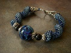 Lmpwork focal bead + seed beads + Indespiral = pretty bracelet