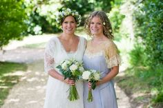 Bridesmaid wears blue lace dress with flowers in her hair  | Photography by http://especiallyamy.co.uk/