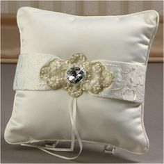 "WeddingDepot.com ~ Ring Bearer Pillow - Devotion - Ivory ~ An embroidered ribbon spans the pillow's front to add depth to the design.  Pillow measures 7"" square. Back has a hand-band for easier holding."