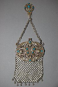 An attractive butterfly filligree purse with chatelaine clip, circa 1915, inset with turqoise beads, 11cm, 4 1/2in long